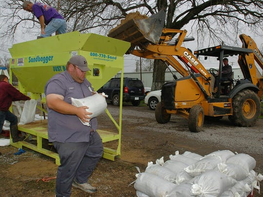 Municipal workers with the town of Krotz Springs prepares sandbags Friday in anticipation of flooding conditions in and around the Krotz Springs area.