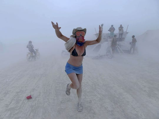 Rebeccah Sheftall dances during a dust storm at Burning