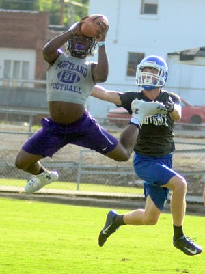 Portland High senior Emmanuel Johnson leaps to catch a pass against Macon County during Trousdale County's 7-on-7 workouts on Tuesday afternoon.
