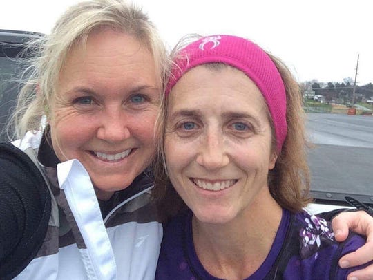 Chambersburg's Laurie Dymond (right) and Waynesboro's Angie Fuss (left) both have something to celebrate this holiday season: Five years of running at least one mile every day.