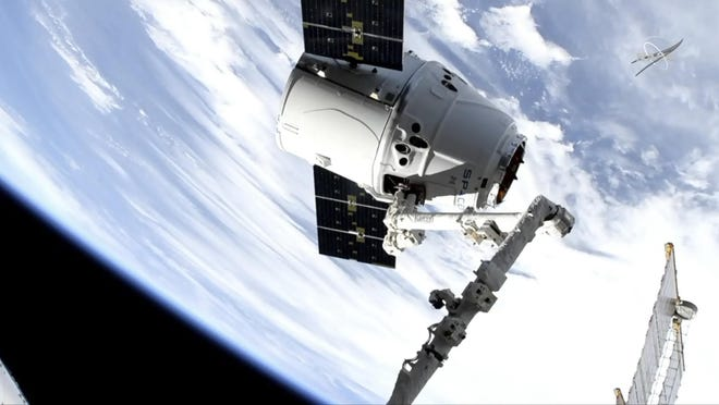 In this image taken from NASA Television, a SpaceX shipment arrives at the International Space Station following a weekend launch, Monday, May 6, 2019. The Dragon capsule reached the orbiting complex Monday, delivering 5,500 pounds of equipment and experiments.