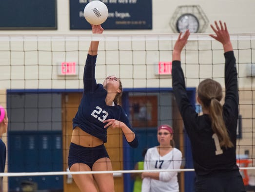 Greencastle's Keri Gearheart tips the ball over the