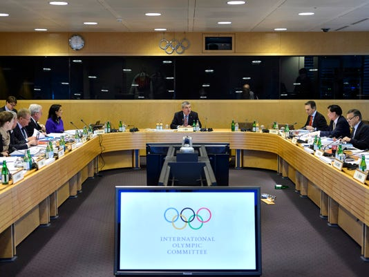 International Olympic Committee, IOC, president German Thomas Bach, center, and executive members attend the opening of an executive board meeting of the IOC at their headquarters in Lausanne, Switzerland, Tuesday, Dec. 8, 2015. (Laurent Gillieron/Keystone via AP)