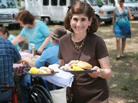 Residents from several Chelsea Senior Living locations in New Jersey attended a picnic at Thompson Park in Jamesburg on July 13, 2016. East Brunswick location lifestyle director Bonnie Schechter brings food to residents at the picnic.