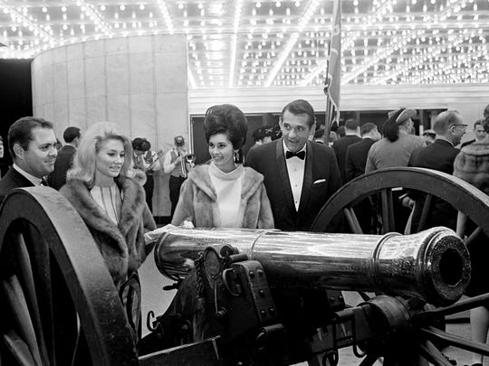 """Civil War costumes and even an antique cannon was part of the current premiere showing of the movie, """"Gone With the Wind,"""" at the Belle Meade Theater Dec. 21, 1967. Mr. and Mrs. Don Young, left, and Mrs. and Mr. Charles Kuertz are checking out the cannon at the charitable event sponsored by the Junior Department of the Woman's Club."""