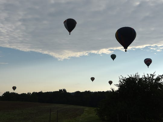 Scenes from the 6 a.m. hot-air balloon launch during