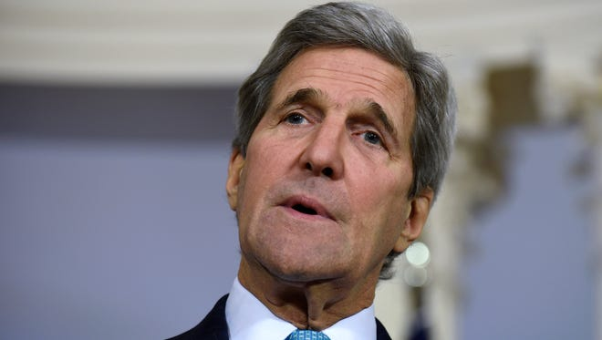 """In this March 9, file photo, Secretary of State John Kerry speaks to reporters at the State Department in Washington. The Obama administration was nearing a decision on whether to formally declare that Islamic State group atrocities against religious minorities, including Christians, constitute """"genocide."""" Kerry was leaning toward making the determination."""