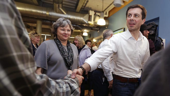 Democratic presidential candidate South Bend Mayor Pete Buttigieg shakes hands with an employee during a campaign stop at a dairy company in Londonderry, N.H., Friday, April 19, 2019. (AP Photo/Charles Krupa)