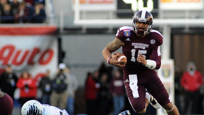 """""""I'm trying to push myself to do things I've never done, and I want to be a great leader for this team and make sure they feel the same things,"""" says Mississippi State quarterback Dak Prescott, the MVP of the Liberty Bowl last season."""