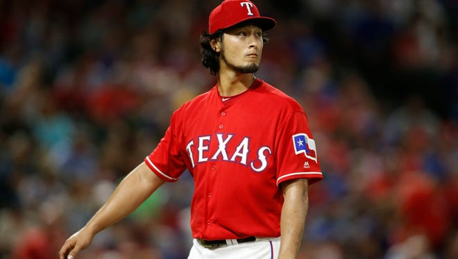 Texas Rangers starting pitcher Yu Darvish (11) watches a replay as he leaves the field in the fifth inning against the Oakland Athletics at Globe Life Park in Arlington on Aug. 17.