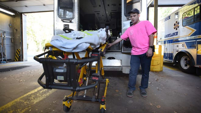 Capt. Izzy Infield demonstrates the Stryker power-load system with Stryker power pro stretchers (new version) at the Teaneck Volunteer Ambulance Corps in Teaneck on 10/19/17. The Teaneck Volunteer Ambulance Corps received equipment through a $125,000 federal grant.