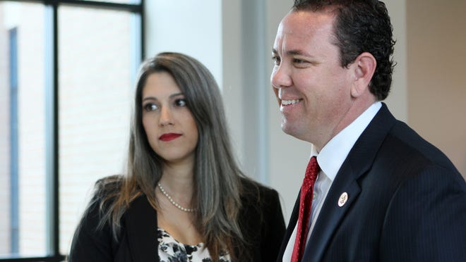 Republican Rep. Vance McAllister, right, and his wife Kelly, check in at Monroe Regional Airport on their way to Washington, in Monroe, La., Monday, April 28, 2014. McAllister said Monday that he will not seek re-election this fall after being caught on video kissing a married female aide, but he intends to finish out his term. (AP Photo/The News-Star, Emerald Mcintyre) NO SALES ORG XMIT: LAMON501