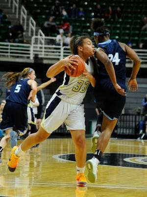 DCD's Destiny Pitts leans in a bit to get the foul on South Christian's Markayla Vander in the second quarter.