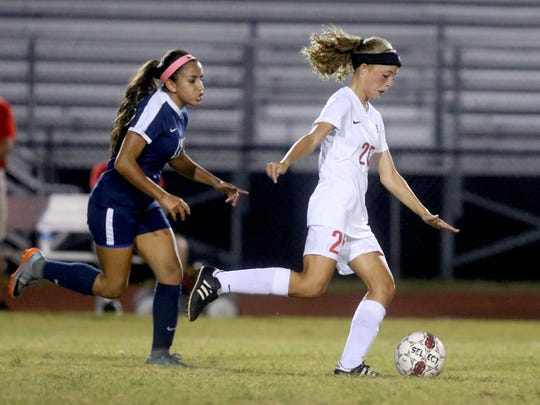 Stewarts Creek's Delaney Mitchell (right) is one of the area's top returning scorers.