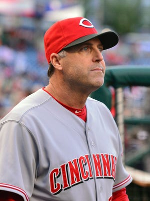 Cincinnati Reds manager Bryan Price (38) stands in the dugout during the first inning Washington Nationals at Nationals Park.