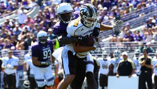 Western Michigan Broncos tight end Donnie Ernsberger (85) makes a catch against Northwestern Wildcats safety Godwin Igwebuike (16) during the fourth quarter at Ryan Field.