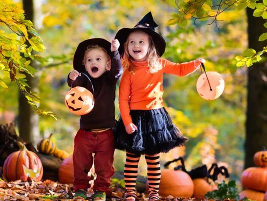 Beautiful kids with pumpkins on Halloween