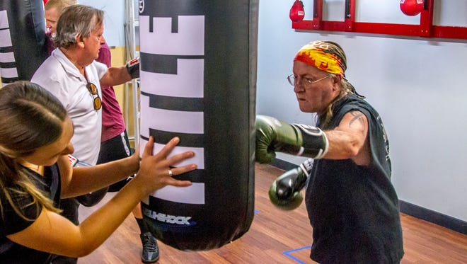 The Rock Steady Boxing class holds a session at Snap Fitness in Cedar City on Thursday, October 9, 2017.