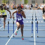 Male's Hadiya Williams, center (406), breaks for the finish line in the girl's 100 meter hurdles. May 23, 2015