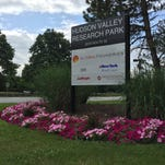 "GlobalFoundries employees were told Monday, Oct. 12, 2015, that the plant plans to cut a ""few"" workers from its East Fishkill site. GlobalFoundries put its name and logo on the signboard marking the Hudson Valley Research park earlier in 2015."