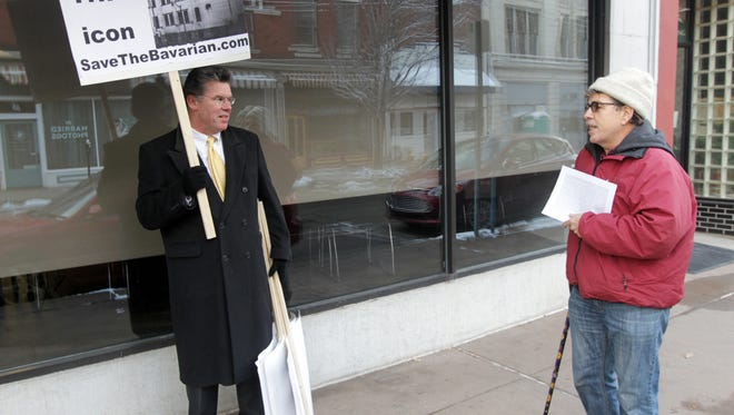 Doug Newberry (left), founder of Save the Bavarian, a group opposed to the demolition of the 1877 Bavarian Brewing Co. Building in Covington, talks with Carl D. Fox, another opponent of the demolition, outside Covington City Hall prior to a meeting of the city's Historic Preservation Board.  The board is considering a request by the building's owner, Columbia Sussex Corporation, for a permit to raze the structure.