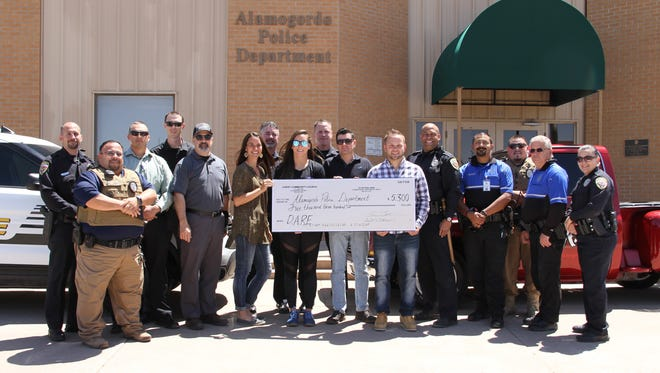 Christ Community Church presented a $5,300 donation to Alamogordo Police Department's DARE program May 3.
