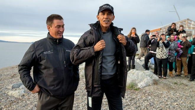 President Barack Obama meets with Kevin Baker, the 2011 Iditarod winner, on Sept. 2 in Kotzebue, Alaska.