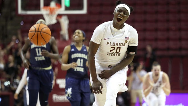 FSU's Shakayla Thomas screams out after a key defensive block in the final minutes of the Seminoles' 64-61 win against Georgia Tech at the Tucker Civic Center on Sunday, Feb. 25, 2018.