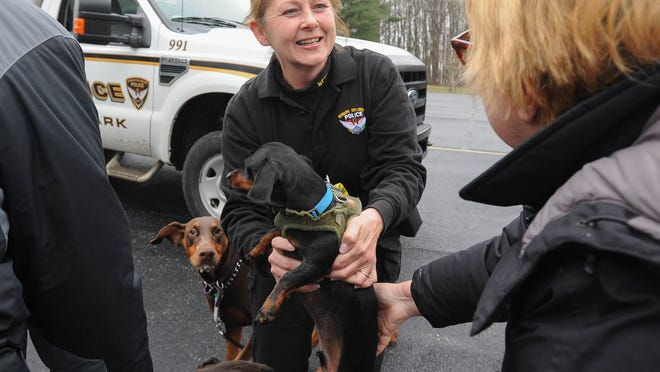 Newark's only Animal Control Officer Donna Vickers, who recently celebrated her 25th anniversary on the job, plays with Rocky, a four-year-old Dachshund at the First Church of the Nazarene in Newark.