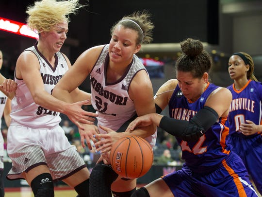 Aubrey Buckley (21) and Audrey Holt (left) battle for