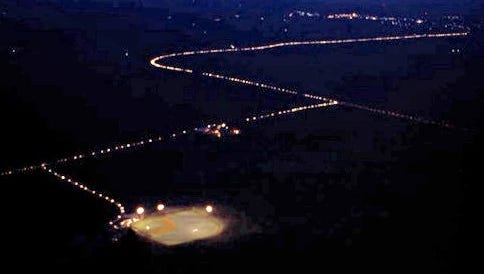 In the final scene of Field of Dreams, a line of headlights can be seen from those who want to see the baseball diamond in the middle of a corn field. Rick Cleveland says that scene was similar to those wanting to purchase a Powerball ticket in Mound, Louisiana, on Friday.