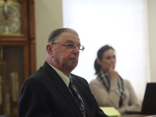 Henry Rayhons listens to testimony Friday, April 10,