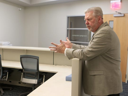 James Waddington, executive director of he Kent Economic Partnership, Inc., explains the different rental space options available at the new Kent County Emerging Enterprise Development Center in the Kent County Levy Court complex.