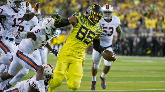 Sep 10, 2016; Eugene, OR, USA; Oregon Ducks tight end Pharaoh Brown (85) runs against the Virginia Cavaliers defense in the first quarter at Autzen Stadium. Mandatory Credit: Cole Elsasser-USA TODAY Sports