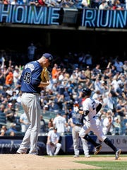 Tampa Bay Rays pitcher Ryan Yarbrough reacts after giving up a solo home run to New York Yankees' Giancarlo Stanton during the fifth inning of a baseball game on Saturday, June 16, 2018, in New York.
