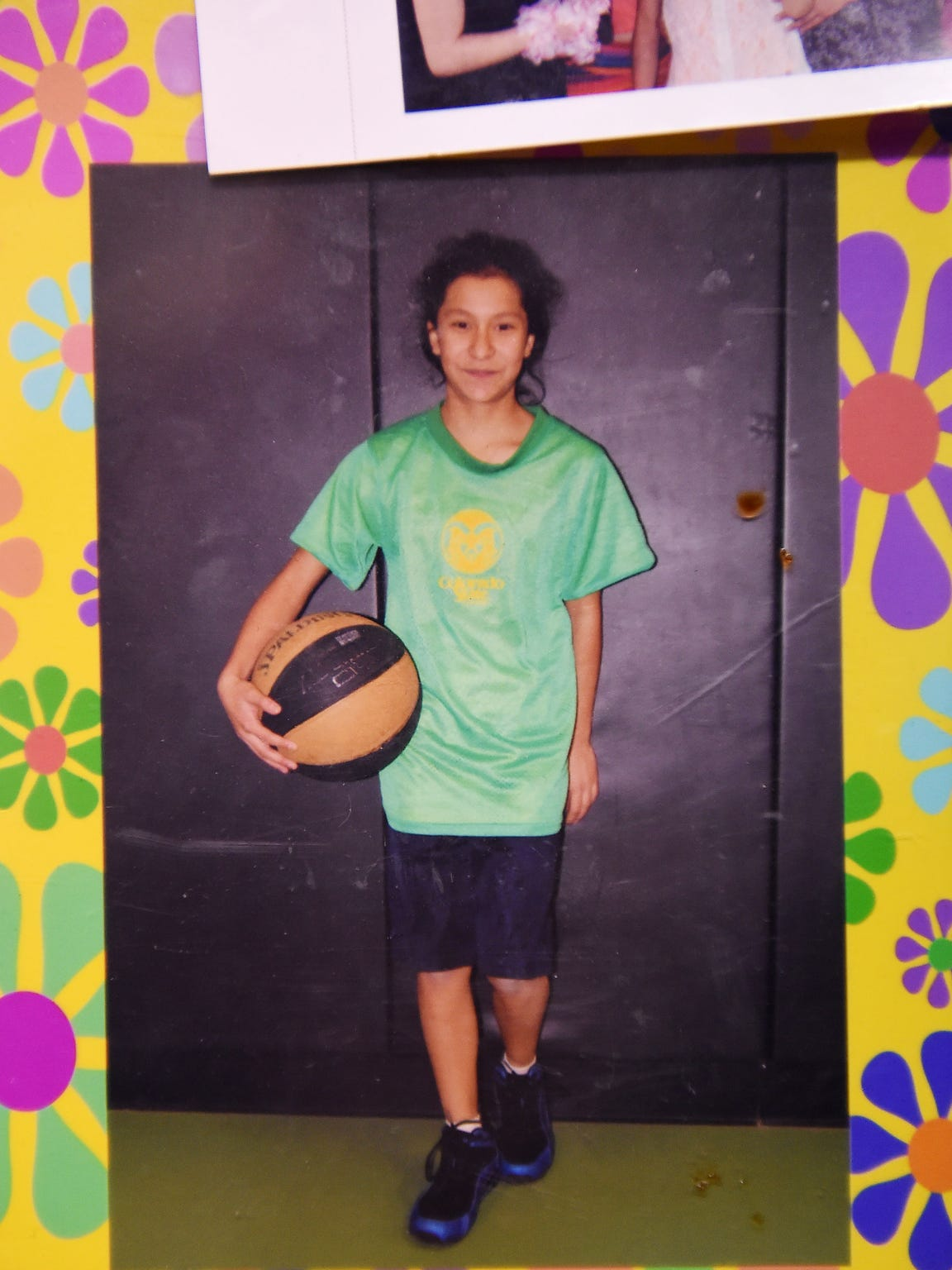 Ariana poses with a basketball in 2013 at Riffenburgh Elementary School.