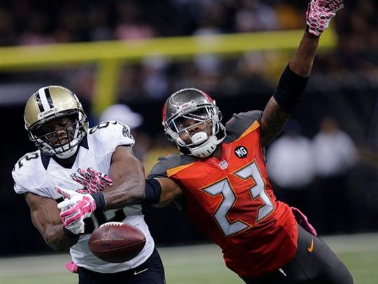 Tampa Bay Buccaneers strong safety Mark Barron (23) breaks up a pass intended for New Orleans Saints tight end Benjamin Watson (82) in the second half of an NFL football game in New Orleans, Sunday, Oct. 5, 2014. The Saints won 37-31. (AP Photo/Bill Haber)
