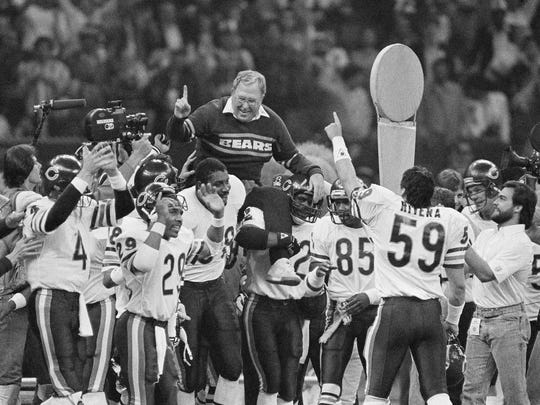 Chicago Bears defensive coordinator Buddy Ryan is carried