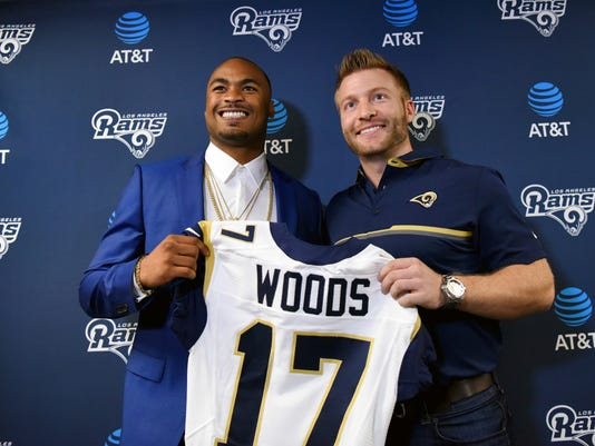 Los Angeles Rams newly signed free agent wide receiver Robert Woods, left, poses for a photo with Rams head coach Sean McVay during a news conference at the NFL Rams' training facility in Thousand Oaks, Calif., Friday, March 10, 2017. (AP Photo/Michael Owen Baker)
