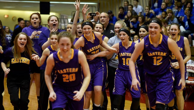 Eastern High School players celebrate after beating Covenant Christian as Richmond High School hosts the girls Class 2A semi-state basketball championship Saturday, Feb. 18, 2017, in the Tiernan Center.