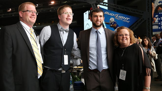 Colts' quarterback Andrew Luck poses for a picture with David and Lisa Spidel along with their son, Josh, before the event. IndyStar held the Indiana Sports Awards, Thursday, April 28, 2016 at Lucas Oil Stadium where they honored the outstanding accomplishments of 200+ high school athletes in 28 sports. The featured guest speaker was Indianapolis Colts' quarterback Andrew Luck. The evening's host was WNBA Indiana Fever Head Coach Stephanie White. Celebrity presenters included Indiana Fever All-Star Tamika Catchings, IndyCar driver Ed Carpenter and IndyStar's own sports columnist Gregg Doyel.