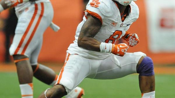 Clemson cornerback Darius Robinson (8) reacts after intercepting a Syracuse pass during the 3rd quarter in the Carrier Dome in Syracuse, N.Y. in a 2013 game.