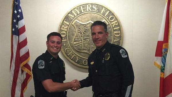 Former chief Doug Baker swearing in former officer Matthew Vagi in January 2015.