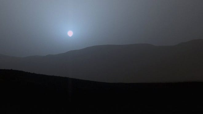 NASA's Curiosity Mars rover recorded this image of the sun setting at the close of the mission's 956th Martian day, or sol, April 15, 2015, from the rover's location in Gale Crater.
