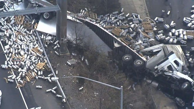 Beer containers litter I-95 as the result of a truck that fell from an overpass.