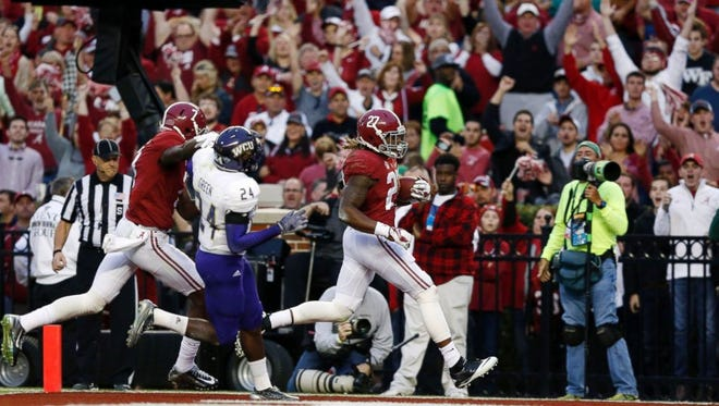 Alabama sophomore Derrick Henry had two rushing touchdowns in Alabama's 48-14 win Saturday over Western Carolina at Bryant-Denny Stadium.