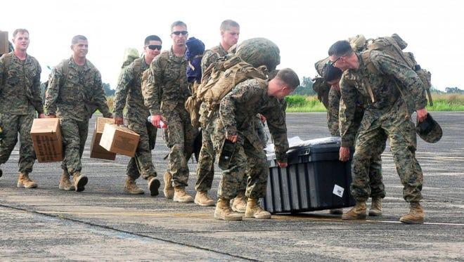 U.S. Marines arrive at the Roberts International airport in Monrovia, Liberia.