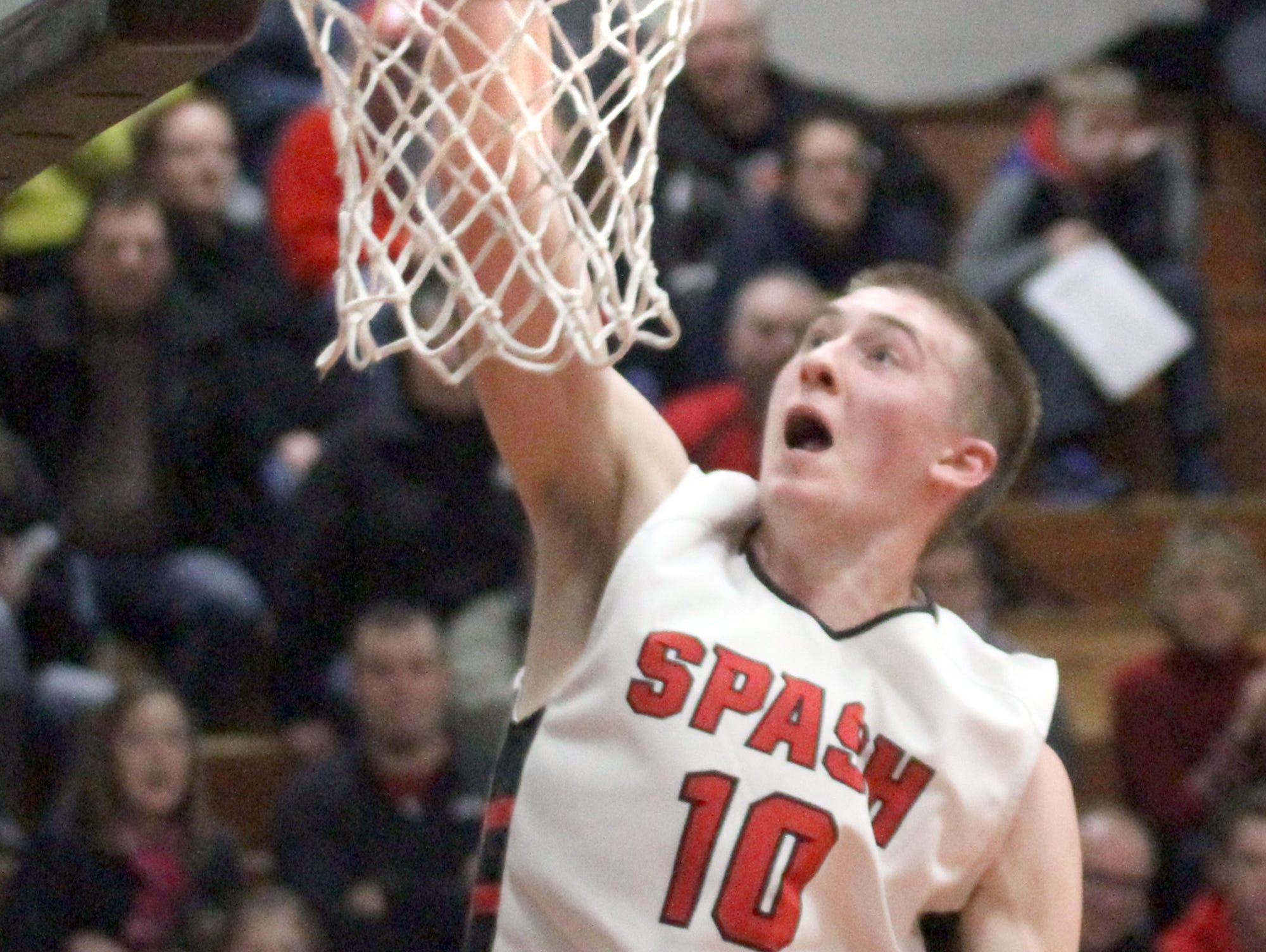 SPASH's Sam Hauser dunks the ball against Sheboygan South last season in Stevens Point.