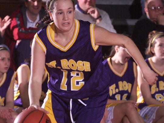 Kim Hughes of St. Rose drives during a 1999 game for the Purple Roses.