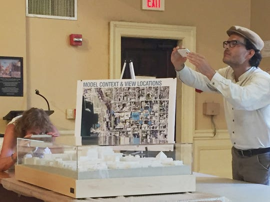 A matter of perspective: Burlington residents Alex Lavin and Carolyn Bates photograph a scale model of a proposed redevelopment of Burlington Town Center. The model was unveiled in Contois Auditorium prior to a meeting of the City Council Ordinance Committee. Photographed on Tuesday, Aug. 9, 2016.